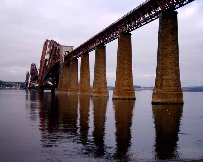 The bridge traverses the Firth of Forth at a pinch point with islets,