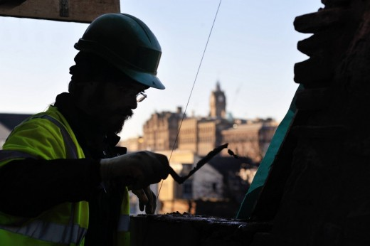 Professional carrying out maintenance on property - Edinburgh World Heritage Guidance